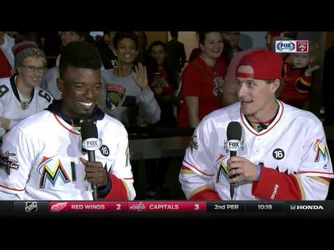 Miami Marlins players Dee Gordon and Tom Koehler stop by Florida Panthers game