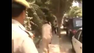 Police officers fight each other in public