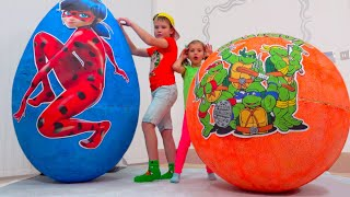 Max and Katy their toys in Big Surprise Eggs