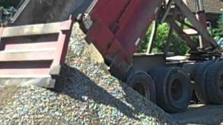 MACK Dump truck dumping gravel