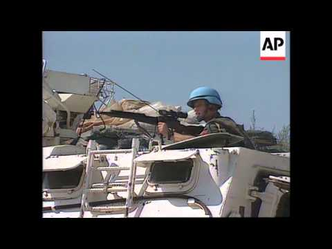 Bosnia - Snipers Fire At Media Vehicles