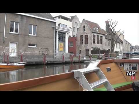 The boatman entertains, canal trip, Ghent, Belgium