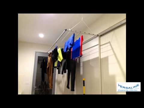 automatic clothesline retrieval system Automatic storage /retrieval systems the automatic loading system consists of an arm on the storage conveyor belt the conveyor is designed to store garments the delivery at the automatic door is performed by smaller conveyor.