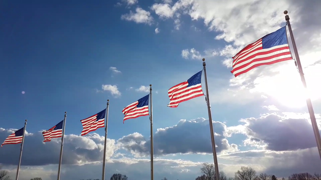 American flag waving in the wind at Washington Monument ...