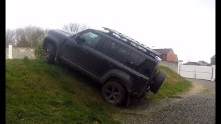 New Land Rover Defender Offroad climbing a steep bank