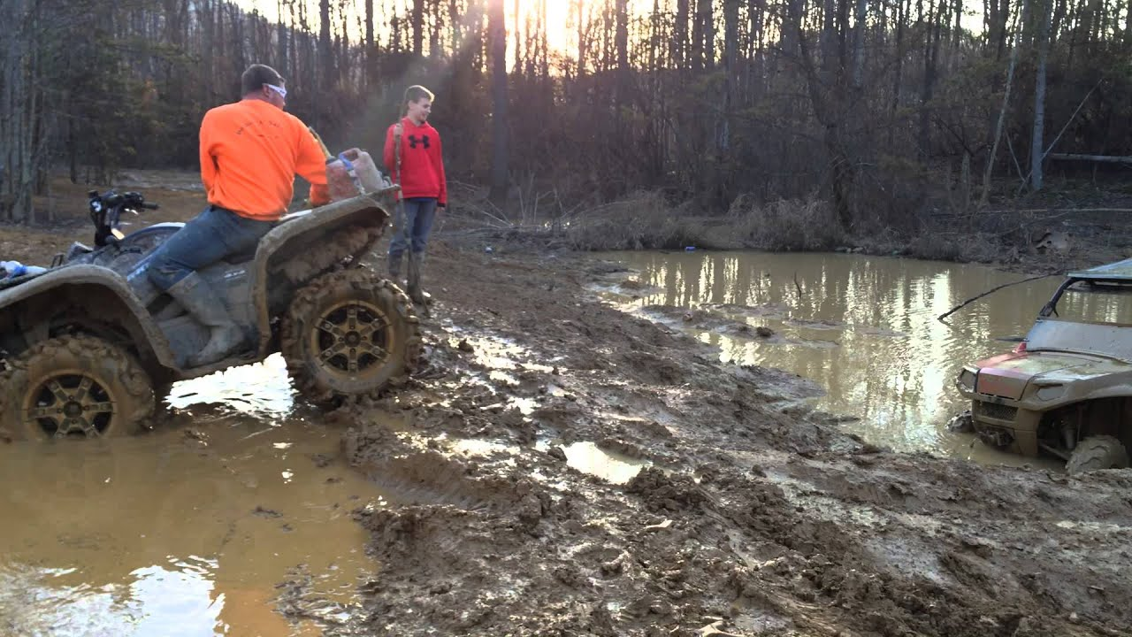 Crazy driver in stock polaris 570 rzr skimming across a mud hole