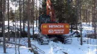 På väg ut från att ha grävt ner en myr stolpe till Vattenfall. färd...