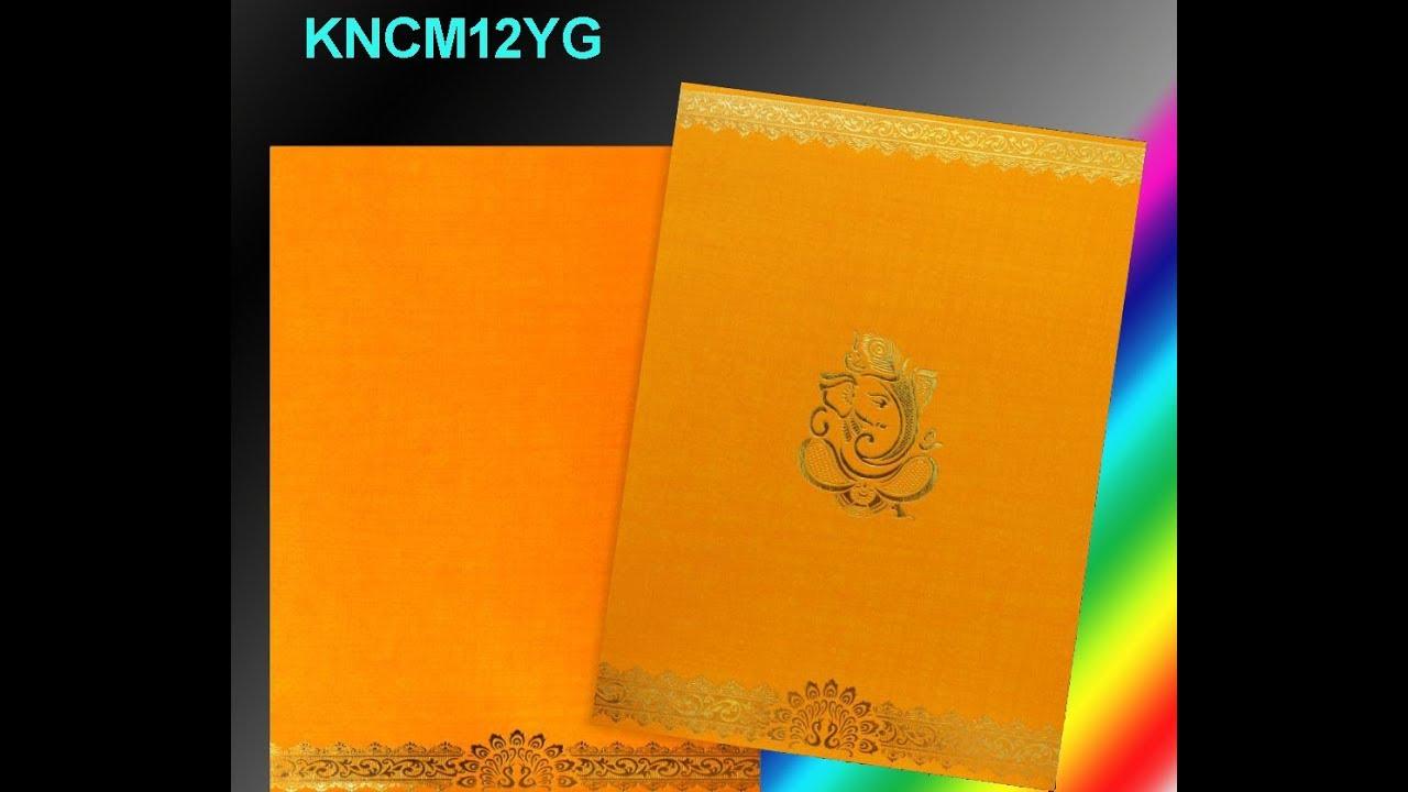 classic yellow ganesha golden border wedding card