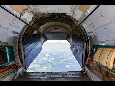 Antonov 12 - Ruby Star | open cargo door inflight over Belarus