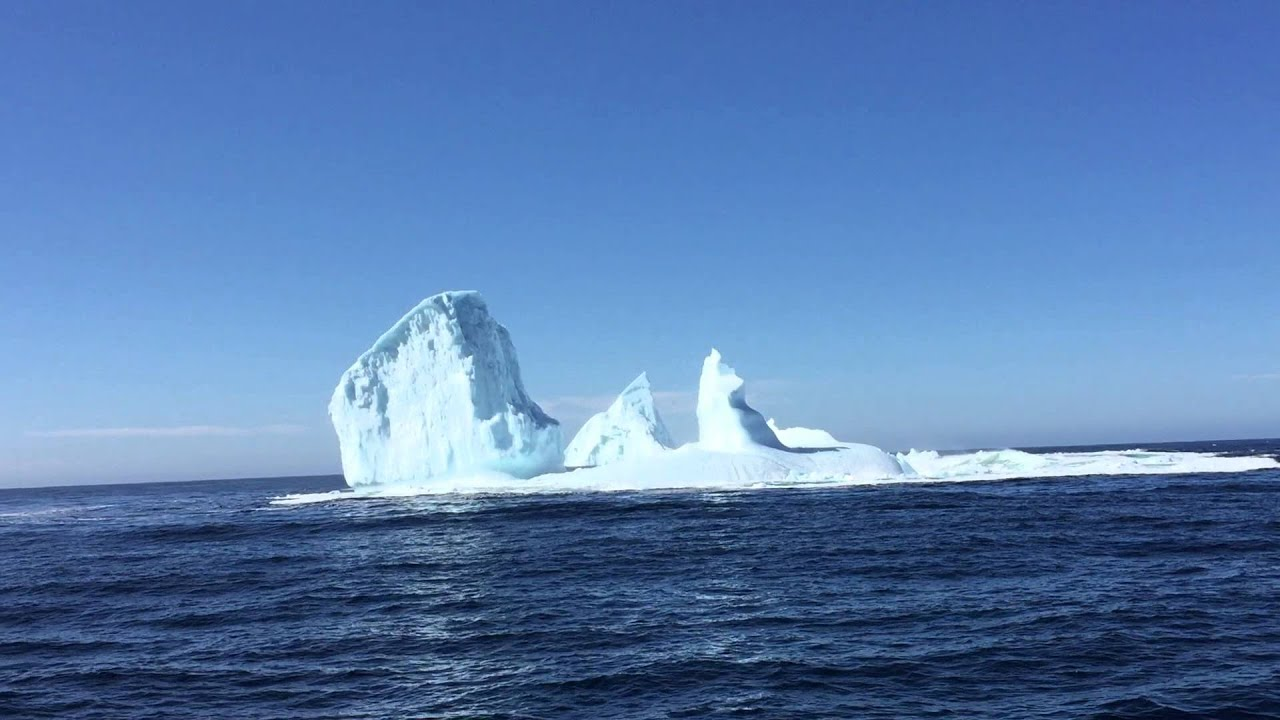 release date 0af7b 71dd9 Iceberg Man and tourists view Iceberg foundering off Twillingate,  Newfoundland & Labrador