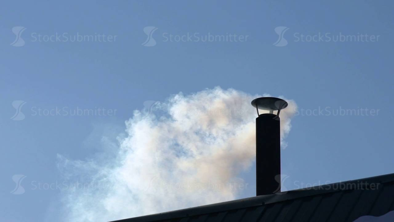 the house with a chimney smoke in the blue sky smoke stacks