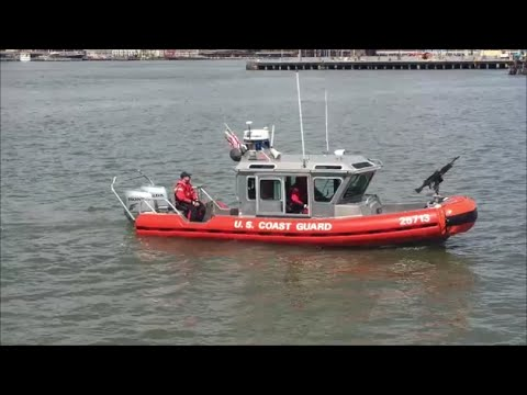 United States Coast Guard Defender Class Boat On Patrol In The Brooklyn Bridge Park Pier In NYC