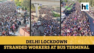 Amid lockdown, migrant workers swamp Delhi bus terminal, desperate to go home