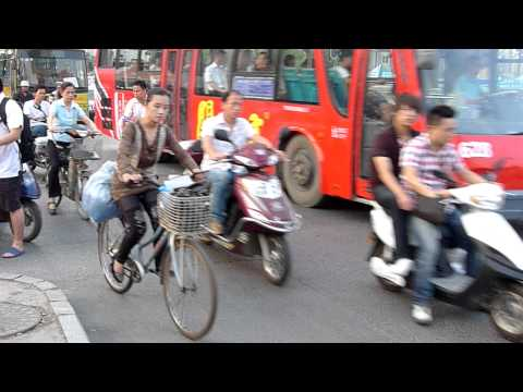 Wow - Crazy Traffic in Wuhan China Motorbike - No Helmets?