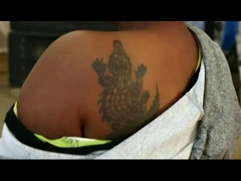 LADY INITIATED THROUGH CROCODILE TATTOO