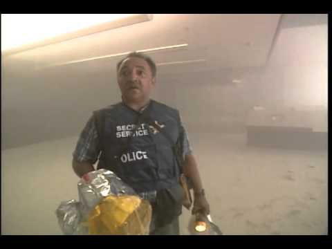 911 CBS WTC nuclear demolition man with construction helmet in WTC-7 lobby.