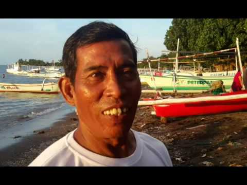 Documentary. Walk along Lovina beach, boats, people..Bali, Indonesia. 2016