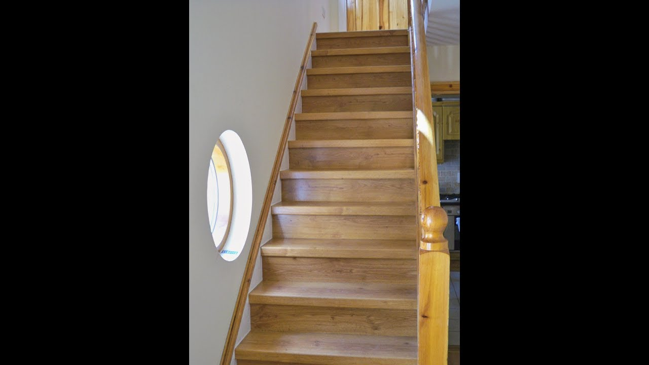 STAIR RENOVATION,STAIR MAKEOVER,LAMINATE STAIRS,INSTALLING LAMINATE  FLOORING ON STAIRS