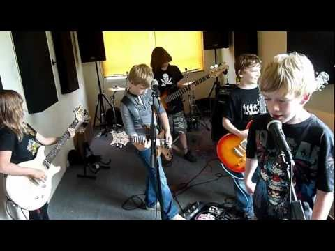 The Mini Band rehearsing a mix of Linkin Park's One Step Closer and their song Ain't No Other Way