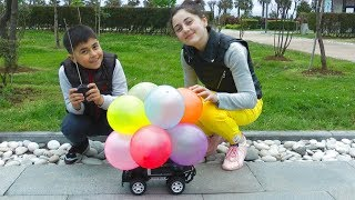 Guka and Maria Pretend Play Driving  a Toy Cars with Balloons and Have Fun