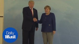 Merkel and Trump shake hands as he enters the G20 summit - Daily Mail