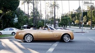 Gold Rolls Royce causes a car to crash