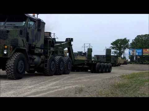 M747 60 Ton Military Trailer Pulled by Oshkosh M1070 HET