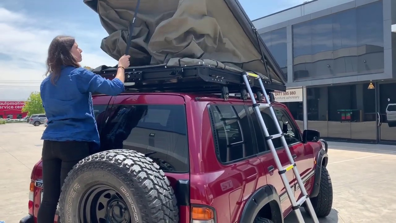 the bush company alpha rooftop tent set up by tough touring