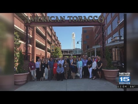 Community leaders tour American Tobacco Campus, a GE Campus model