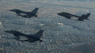 Why is the US provoking N Korea with military drills?