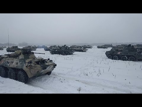 Russian troops operate huge tanks and cannons in the snow