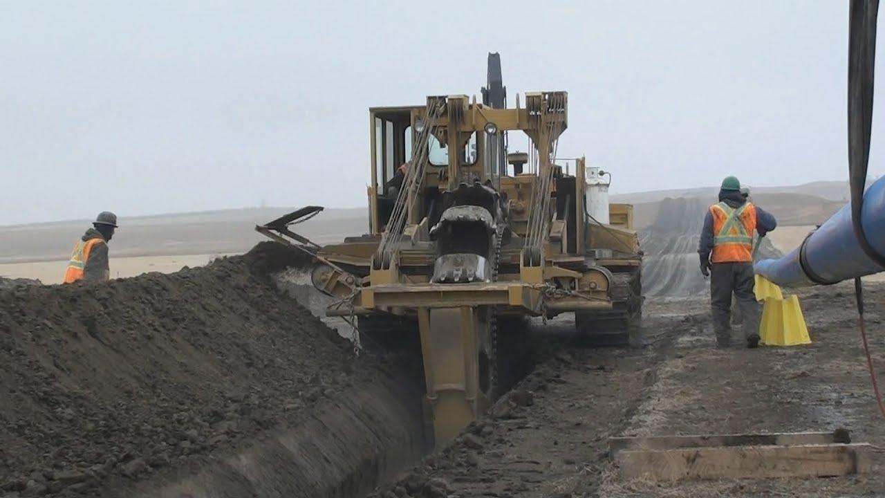 Trenching Machines Working : Pipeline equipment trenching wheel in action youtube