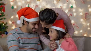 Happy Indian family wishing Merry Christmas to each other