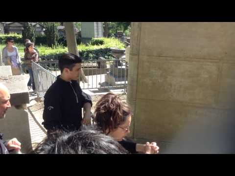 At Jim Morrison's Grave at Pere Lachaise Cemetery in Paris, France
