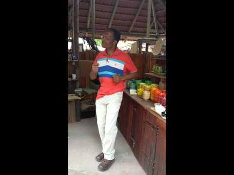 Bryanston Organic Market Peter dancing in his stal