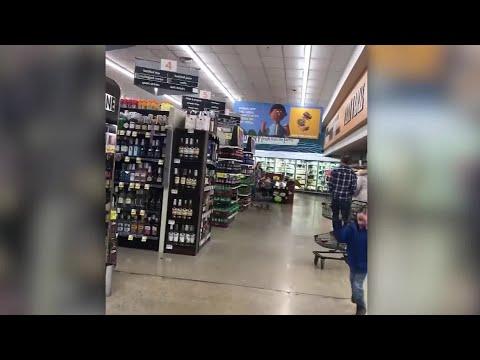 Deer runs through grocery store