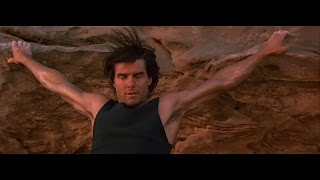 Ethan Hunt climbing rocks with his bare hands. At the top he gets t...