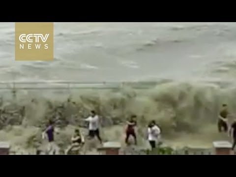 Footage: Tidal storm surge sweeps visitors off their feet in Hangzhou