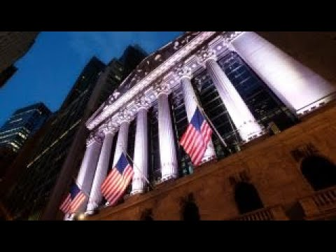Dow pares losses after Trump's tariffs spur volatility