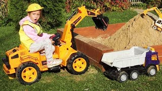 Sofia on a Toy Excavator makes a Children's sandbox