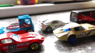 Toy Cars Forming Two Lines On The Table