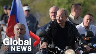 Vladimir Putin attends bike show on annexed peninsula of Crimea