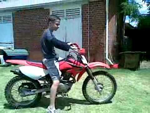 2008 Honda CRF 100F lap around my backyard - YouTube
