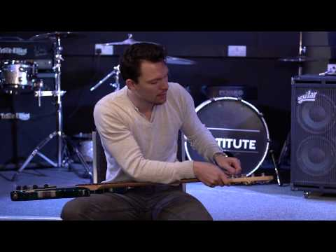 Re-stringing a bass guitar - How to play bass guitar lesson one