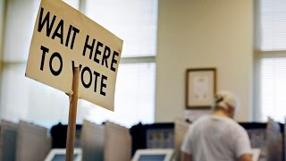 Deadline looming for CA primary voter registration 10/8/14 Janet West explores the Voter Registration forms on display at Rep Linda Sanchez Cerritos