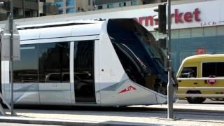 Dubai tram approaching Jumeirah Lakes Towers Station - 13 December 2015