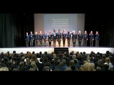 'One moment, one people' performed by The Premier Academy