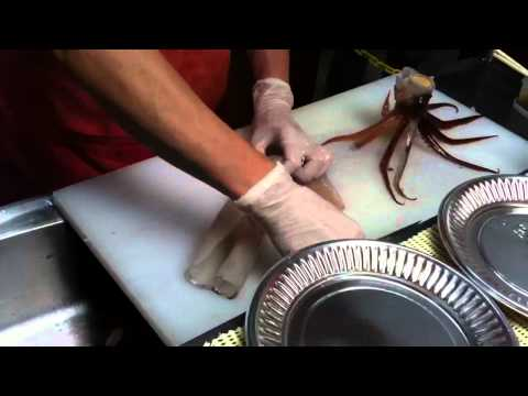 Cutting squid from alive to sashimi at Hakodate Fish Market