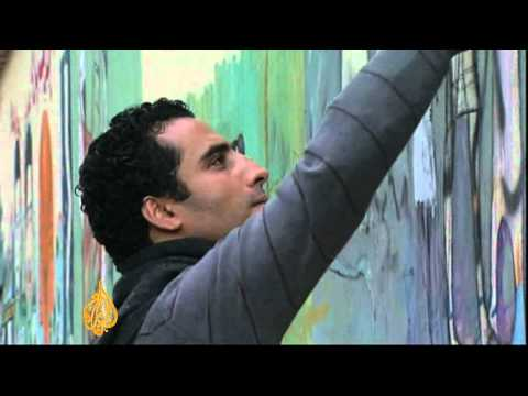 Artists use graffiti to tell Egypt revolution's stories