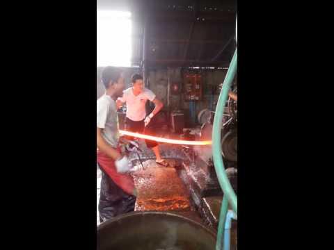 Hot asians working glowing metal poles